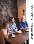 two women and a man at cafe ... | Shutterstock . vector #563217223