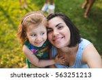 smiling girl hugging mother on... | Shutterstock . vector #563251213