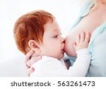 mother breastfeeding her... | Shutterstock . vector #563261473