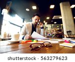 young businessman analyzing... | Shutterstock . vector #563279623