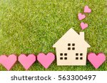 wooden house toy and paper box... | Shutterstock . vector #563300497
