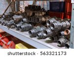 Small photo of Alloy Steel Threaded Fittings on the shelf in warehouse facilities.