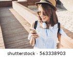 happy beautiful girl using... | Shutterstock . vector #563338903