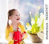 Cute Girl Watering First Sprin...