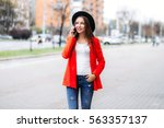 Young Woman In Black Hat Using...