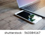 computer laptop and white... | Shutterstock . vector #563384167