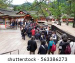 people line up to enter... | Shutterstock . vector #563386273