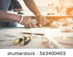 electrician working on design... | Shutterstock . vector #563400403