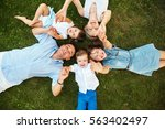 happy playful family lying on... | Shutterstock . vector #563402497