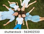 happy playful family lying on... | Shutterstock . vector #563402533