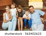 happy playful family on the... | Shutterstock . vector #563402623