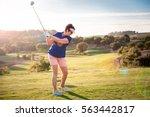 mature woman playing golf.... | Shutterstock . vector #563442817