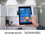 male hand holding tablet with... | Shutterstock . vector #563444383