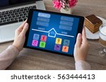 woman hands holding tablet... | Shutterstock . vector #563444413