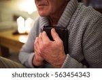senior man praying  holding... | Shutterstock . vector #563454343