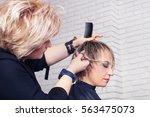 women's haircut. hairdresser ... | Shutterstock . vector #563475073