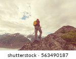 hiking man in canadian... | Shutterstock . vector #563490187