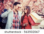 cheerful couple shopping... | Shutterstock . vector #563502067