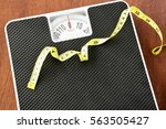 Measuring Tape On Black Weight...