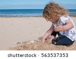 Small Girl On A Sandy Beach...