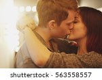 romantic couple touching and... | Shutterstock . vector #563558557