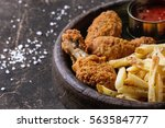 fried chicken legs with french... | Shutterstock . vector #563584777