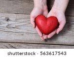 red hart on palms   hart...   Shutterstock . vector #563617543