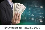 businessman holding dollar... | Shutterstock . vector #563621473