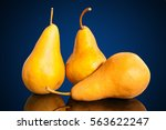 Three Yellow Pears On A Glass...