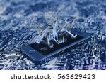 smartphone on printed circuit... | Shutterstock . vector #563629423