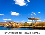 boats and floating islands made ... | Shutterstock . vector #563643967
