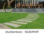 stone way in green grass. - stock photo