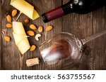 red wine with cheese on wooden... | Shutterstock . vector #563755567