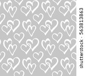 seamless pattern with hearts.... | Shutterstock .eps vector #563813863