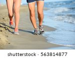 close up legs of young couple... | Shutterstock . vector #563814877