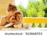 little boy eats himself sitting ... | Shutterstock . vector #563868553