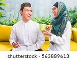 asian muslim man and woman... | Shutterstock . vector #563889613