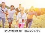 group of jogging people... | Shutterstock . vector #563904793