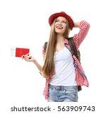woman traveler with passport... | Shutterstock . vector #563909743