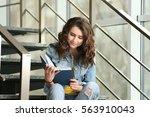 beautiful young woman reading... | Shutterstock . vector #563910043