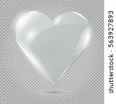 glass heart on a transparent... | Shutterstock .eps vector #563927893
