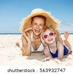 family fun on white sand.... | Shutterstock . vector #563932747