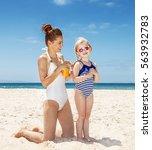 family fun on white sand. happy ...   Shutterstock . vector #563932783