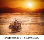 biker in the atacama travels... | Shutterstock . vector #563950627
