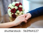 the lovers gently holding hands ...   Shutterstock . vector #563964127