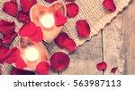 enlightened candles in heart... | Shutterstock . vector #563987113