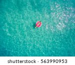 aerial view of young brunette... | Shutterstock . vector #563990953