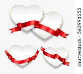 white paper hearts with red... | Shutterstock . vector #563991253