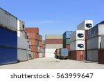 the container stack at  ship... | Shutterstock . vector #563999647