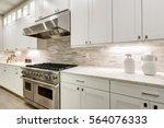 Gourmet Kitchen Features White...